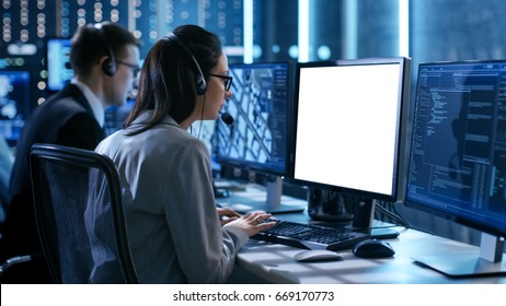 Close up Shot of Female working in a Technical Support Team Gives Instructions with the Help of the Headsets. She Works With White Screen Isolated. Good for Template.