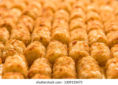 Close up shot of freshly baked tater tot hot dish, shot with a shallow depth of field.