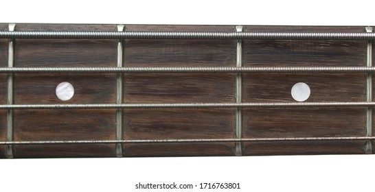 A close up shot of the fretboard of a bass guitar.