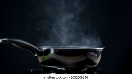 Close up shot of a frying pan on fire steaming