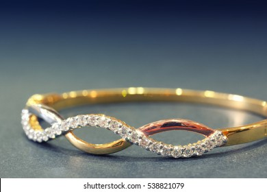 Close up shot of gold diamond bracelet