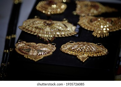 Close up shot of gold jewelry, necklace set, pendent with selective focus. Pure gold 22k jewelry for sale with copy space. Indian real gold pendent set for advertisement.