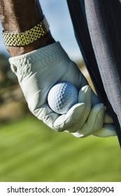 Close up shot of Golfer Holding Golf Ball
