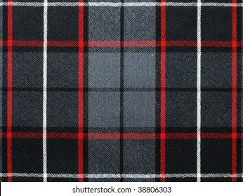Close up shot of grey wool plaid/tartan with red and white stripes.
