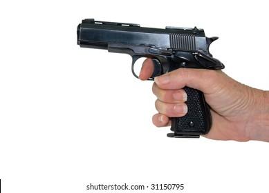 A close up shot of a hand pointing a hand gun.