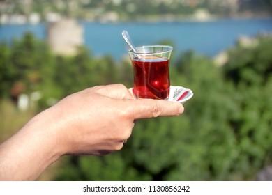 close up shot of a hand serving tea