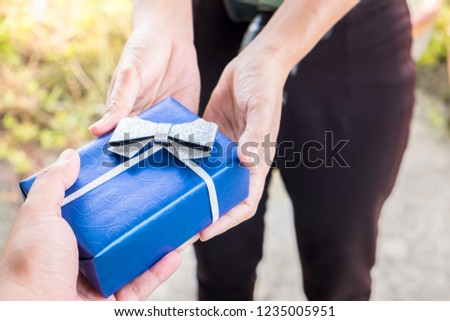 Close Up Shot Of Hand Young Man Giving His Girlfriend Birthday Present Surprising Blue Gift