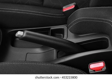 Close up shot of handbrake level and seat belt