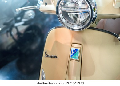 A close up shot of the headlight of a Vespa Scooter. Vespa is an Italian brand of scooter manufactured by Piaggio. International Motorcycle Exhibition, Istanbul 2019.