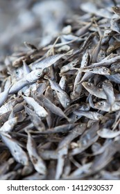 Close shot of heap of dry Mackerel minnows in a fisherman village near Andaman Sea, Mackerel have been overfished and the population may be in danger of collapsing. Flat lay. Top view.