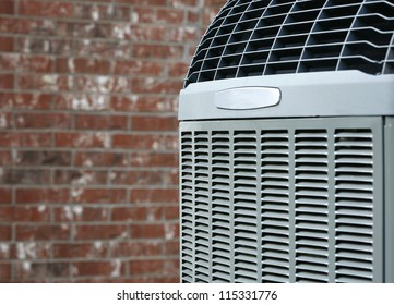 Close up shot of  High efficiency modern AC-heater unit on brick wall background