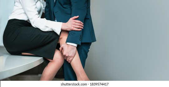 Close up shot of hugging man and woman. Couple of unrecognizable people. Passionate affair at office workplace. Copy space at right.
