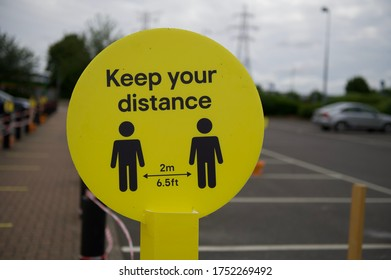 Close up shot of keep your distance sign