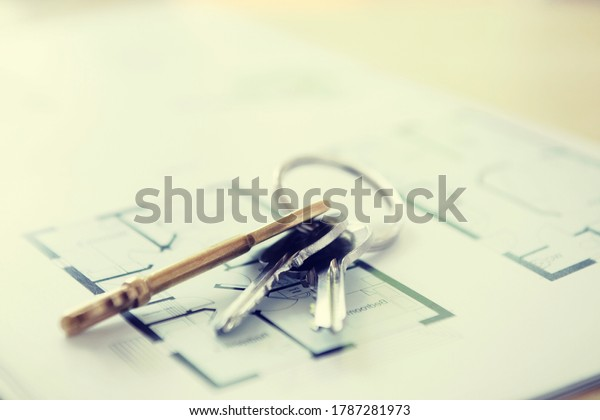 Close up shot of Keys and Floor Plans