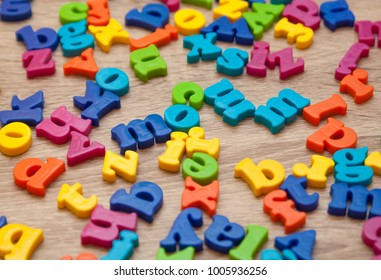 A close up shot of magnetic letters.Plastic alphabet letters.