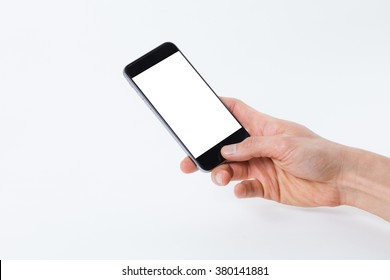 Close up shot of a male hand using a smartphone isolated on white background