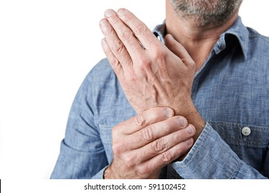 Close Up Shot Of Man Suffering With Repetitive Strain Injury