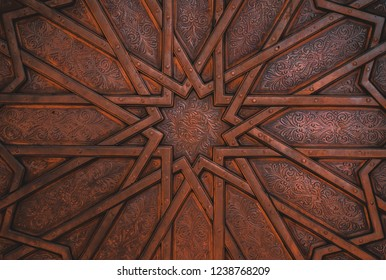 A close up shot of a metal door having beautiful and intricate designs.