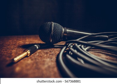 Close up shot of a microphone and some cables.