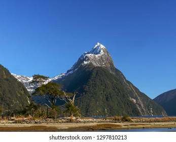 close shot of mitre peak in milford sound, new zealand