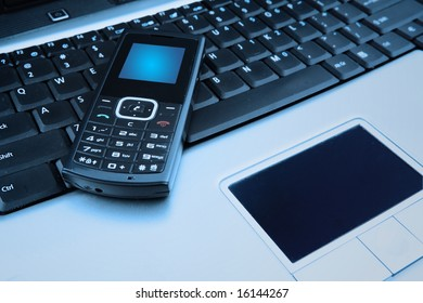 Close up shot of mobile phone and a computer laptop