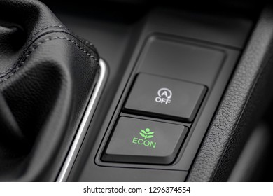 Close up shot of modern car economical, environmental friendly mode switch and engine start/stop switch