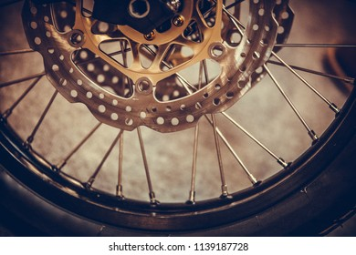 Close up shot of a motorcycle double disk front brake.