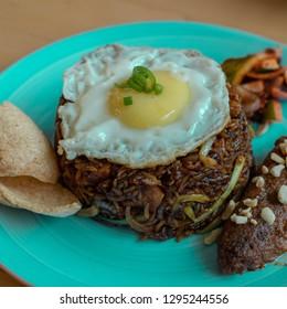 A close up shot of nasi goreng on a plate.