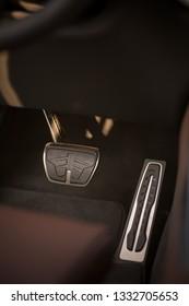 Close up shot of a new car pedals.