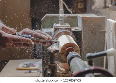 Close up shot of old master carpenter working in his woodwork or workshop. DETAILS