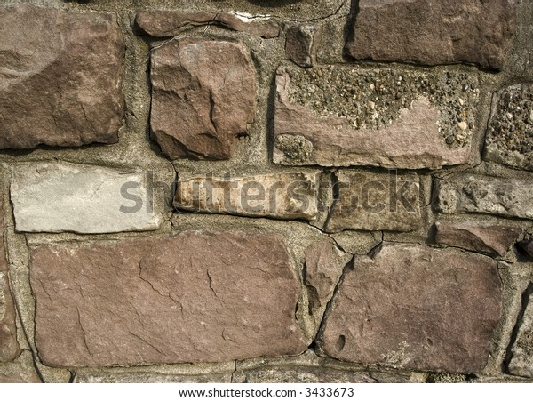 Close shot of an old stone wall to show texture. Great for backgrounds.