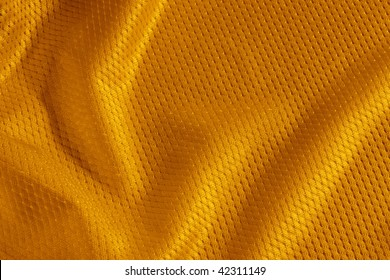 Close up shot of orange textured football jersey