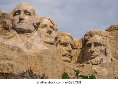 Close up shot of our great leaders, Mount Rushmore on a cloudy day.