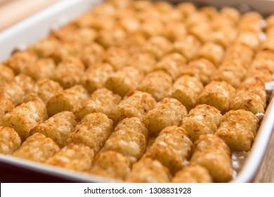 A close up shot of a pan of tater tot hot dish.