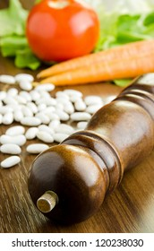 Close up shot of pepper mill and fresh vegetables - selective focus