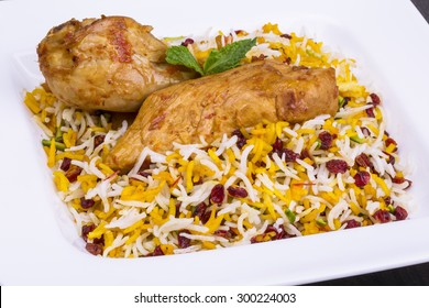 Close up shot of Persian Saffron Rice and Barberries (Zereshk polo) with Chicken