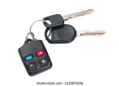 close up shot of plastic remote control car keys on white
