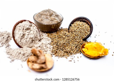 Close up shot of popular Indian & Asian sweet dish or dessert isolated on white its entire ingredients i.e. Rabdi of peral millet or Bajri ki rabdi or Rabdi.