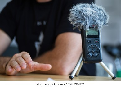 Close up shot of a portable audio recorder during an interview with an unidentified person.