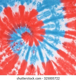 328a3d98 close up shot of red, white and light blue color tie dye fabric texture  background