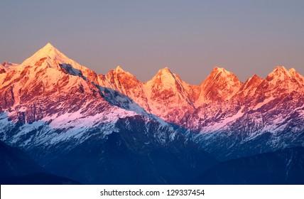 close shot of reddish mountain peaks during sun set