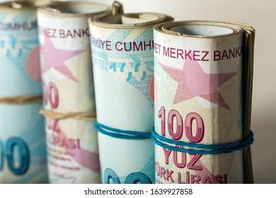 Close up shot of rolled Turkish lira banknotes.