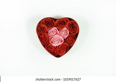 Close up shot of roses inside a love shape steel gift box isolated with white background.