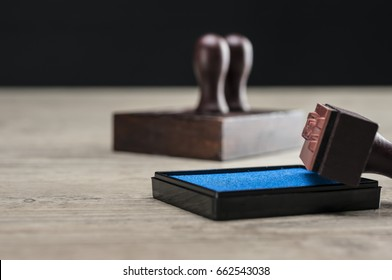 Close up shot of rubber stamps and ink box