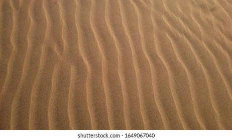 Close up shot of sand shaped by wind