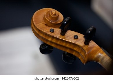 Close up shot of the scroll on a cello or violin.