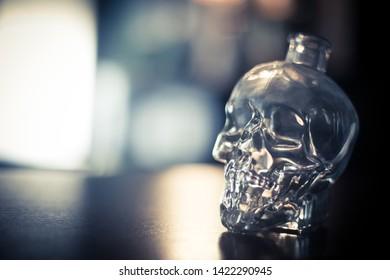 Close up shot of a skull shaped crystal bottle.