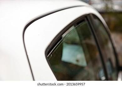 Close up shot of slightly ajar car windows for btter cooling on hot summer day