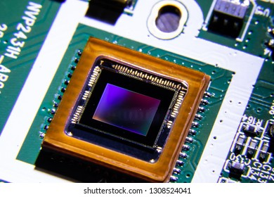 Close up shot of Smartphone CMOS camera sensor reflecting light causing colorful reflection. This semiconductor chip is used in smartphone to capture photo or image.