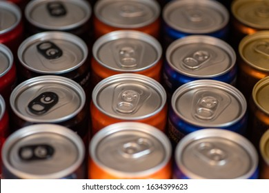 Close up shot of softdrink cans in a row